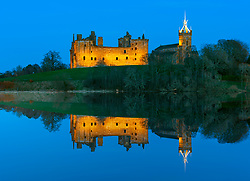 Evening reflection of Linlithgow Palace in lake, Linlithgow, Scotland, UK