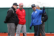 21 February 2015: Duke head coach Chris Pollard (in blue) talks to (from left) umpires Drew Maher and Gerald Trexler, Hartford head coach Justin Blood (in red), and home plate umpire Randy Dulin. The Duke University Blue Devils hosted the University of Hartford Hawks in an NCAA Division I Men's baseball game at Jack Coombs Field in Durham, North Carolina. Duke won the game 5-1.