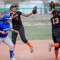 Gallup Bengal Jazmyn Tannie (13) gets backup from teammate LeiLani Yermen (5) as she tries to stop Bloomfield Bobcat Sunshine Tso (10) at third base Thursday at Gallup High School.