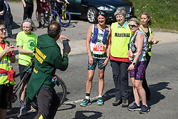 © Licensed to London News Pictures. 19/04/2019. Maidenhead, UK. Prime Minister THERESA MAY poses for a photograph as she helps out as a marshal at the Maidenhead Easter 10 run in her constituency of Maidenhead in Berkshire. Parliament currently on Easter recess after an extension to Article 50 was granted by the EU. Photo credit: Ben Cawthra/LNP