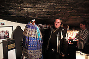 """Roma, Gitan and Manouche gypsies come to pray to Saint Sara, the patron saint of gypsies, in the crypt beneath the church<br /><br />""""Le Pelerinage des Gitans""""; the French gypsy pilgrimage of Saintes Maries de la Mer, Camargue, France<br /><br />Sainte Sara is an uncannonized saint, who legend says looked after the Christian Saints Marie Jacobe and Marie Salome, cousins of Mary Magdalene, who arrived, it is said, on the shores of the Camargue in a rudderless boat. Saint Sara is the patron saint of gypsies who come from far and wide to see her. There are even paintings of Sara as 'Kali' the black saint in Eastern Europe. Sara may have been the priestess of 'Ra' the sun-god or even servant girl to the Christian saints. No-one really knows.<br /><br />For a few weeks of the year, Roma, Gitan and Manouche gypsies come from all over Europe in May, camping in caravans around Saintes Maries de la Mer. It is a festive time where they play music, dance, party and christen their children. They all go to see Saint Sara in the crypt, kissing or touching her forehead. Many put robes on her shoulders, making her fat for the procession. In the main Gypsy procession of the 24th May, Saint Sara is allowed to leave her crypt, beneath the church, and is carried from the church to the shores of the mediterranean and back again. One day a year she is free from her prison. Hundred's of years ago the Gypsies used not even to be allowed into the church, only into the crypt like Sara...<br /><br />Roma gypsies still suffer oppressive prejudice and racism and are one of the ethnic groups the most persecuted and marginalised across Europe. The festival is one of the times where they celebrate with people of all races, their faith and traditions"""