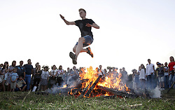 July 6, 2018 - Kiev, Ukraine - People jump over a bonfire during celebration on the traditional Ivana Kupala (Ivan the Bather) holiday, an ancient heathen holiday. The ancient tradition, originating from pagan times, is marked with grand overnight festivities during which people sing and dance around campfires, believing it will purge them of their sins and make them healthier. During the celebrations, people wear wreaths, jump over fires and bathe naked in rivers and lakes. (Credit Image: © Serg Glovny via ZUMA Wire)