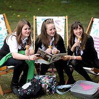 (L-R) S3 pupils Lucy Allan (14), Chloe Hannant (14) and Billie McKinlay (14), from St Thomas of Aquin's School, Edinburgh enjoy the garden area at the Edinburgh International Book Festival. 22nd August 2011.