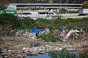 Homeless camp along the Los Angeles River, City of Paramount, South LA, Califortnia, USA,