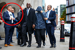 © Licensed to London News Pictures. 21/10/2016. London, UK. Former News of the World journalist MAHZER MAHMOOD walks past former actor JOHN ALFORD (circled left) as he arrives at The Central Criminal Court in London to be sentenced for perverting the course of justice. Former London's Burning actor JOHN ALFORD was the victim of a sting operation by MAHZER MAHMOOD. Photo credit: Tolga Akmen/LNP
