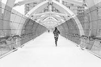http://Duncan.co/man-running-across-pedestrian-bridge