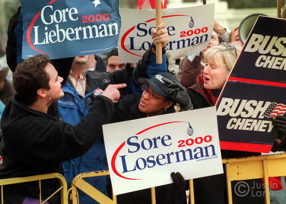 12/11/00--Washington--Attn:NATL--JSL2/Court.The United States Supreme Court heard oral arguments this morning from attorneys representing George W. Bush and Al Gore regarding the Florida recount situation. HERE, John Paul Suttliff, left a Gore supporter, argues with Joyce Saucier, center, and another Bush supporter this afternoon in front of the court..Justin Lane for The New York Times