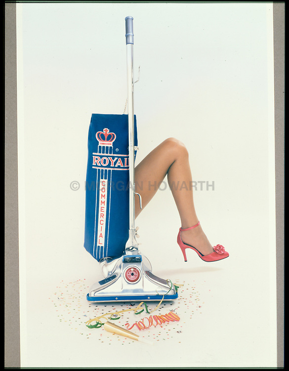 Beautiful womans leg with high heels Leg coming out of Vacuum cleaner bag new Years