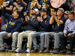 Feb 10, 2018; Morgantown, WV, USA; Country artist Cole Swindell cheers court side during the second half at WVU Coliseum. Mandatory Credit: Ben Queen-USA TODAY Sports
