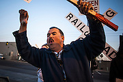 12 MARCH 2012 - PHOENIX, AZ: RICO RODRIGUEZ, who has been a bus driver for 12 years, shouts as busses driven by strike breakers leave the barns in front of the Veolia Transportation bus barns in Phoenix, AZ, Monday. Nearly 900 bus drivers from Amalgamated Transit Union Local 1433  are on strike against Veolia Transportation which is contracted to provide bus service for Valley Metro, the bus service that spans the Phoenix metropolitan area. The routes affected by the strike are in Phoenix and the suburbs of Tempe and Glendale. According to the union, the strike was called because of Veolia's conduct during negotiations, which have lasted more than two years. The union has filed Unfair Labor Practices charges against Veolia with The National Labor Relations Board and the NLRB is taking Veolia before an Administrative Law Judge on April 3, 2012 to answer the charges.         PHOTO BY JACK KURTZ