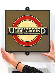 © Licensed to London News Pictures. 15/11/2012. London, UK The original Underground Roundel design from Westminster Station, Edward Johnston, c.1930. The Royal College of Art is celebrating its 175th anniversary with a major exhibition featuring more than 350 works of art and design by over 180 RCA graduates and staff, including Henry Moore, Barbara Hepworth, Tracey Emin, David Hockney, Peter Blake, Bridget Riley and Lucian Freud.  The RCA is the world's oldest art and design university in continuous operation. Its first students comprised a small group of teenage boys; today it educates some 1,200 postgraduate students from 55 different countries.. Photo credit : Stephen Simpson/LNP