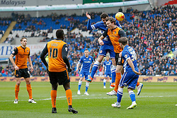 Sean Morrison of Cardiff City and Kevin McDonald of Wolverhampton Wanderers compete in the air - Photo mandatory by-line: Rogan Thomson/JMP - 07966 386802 - 28/02/2015 - SPORT - FOOTBALL - Cardiff, Wales - Cardiff City Stadium - Cardiff City v Wolverhampton Wanderers - Sky Bet Championship.