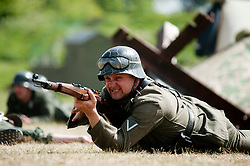 German world war two panzer grenadier from the elite German Großdeutschland Division fires a K98 bolt action rifle from a prone positin during a battle Reenactment at Fort Paull near Hull May 2011 <br /> Image © Paul David Drabble