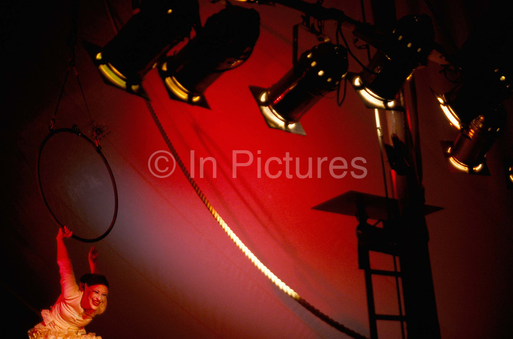 A trapeze artist during her act at Gifford Circus, Marlborough, UK.