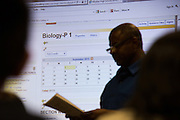 Biology teacher Kenneth Lewis reviews course expectations with parents during Milpitas High School's Back to School Night at Milpitas High School in Milpitas, California, on September 1, 2015. (Stan Olszewski/SOSKIphoto)