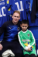 AFC Wimbledon midfielder Mitchell (Mitch) Pinnock (11), Mascot during the EFL Sky Bet League 1 match between AFC Wimbledon and Barnsley at the Cherry Red Records Stadium, Kingston, England on 19 January 2019.