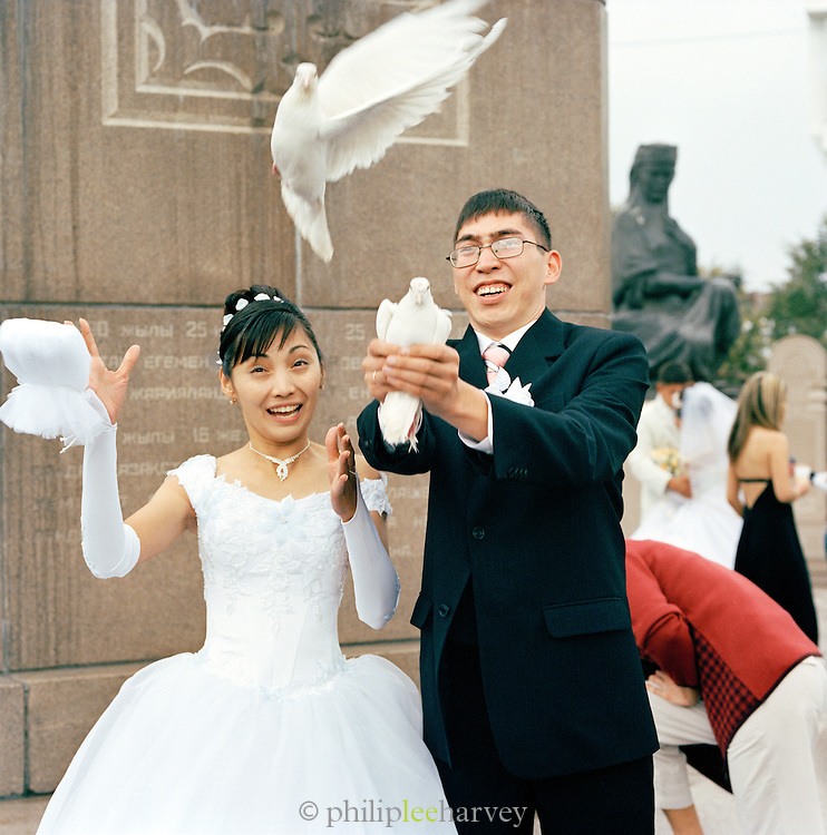 Bride and Groom releasing Doves, Almaty, Kazakhstan