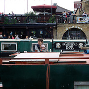 The Regent's Canal is a canal to the north of central London. The canal is frequently used today for pleasure cruising; a regular waterbus service operates between Maida Vale and Camden, running hourly during the summer months.  Regent's Canal in Camden