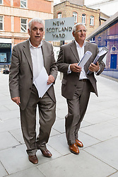 © Licensed to London News Pictures. 09/06/2015. London, UK. Tower Hamlets election petitioner ANDY ERLAM (Andrew Erlam) and businessman, DANNY MARKS arriving outside New Scotland Yard in central London on 8th June 2015. Andy Erlam and Danny Marks delivered new files of alleged evidence of election and financial fraud in Tower Hamlets to the Metropolitan Police Commissioner, Sir Bernard Hogan-Howe. Photo credit : Vickie Flores/LNP