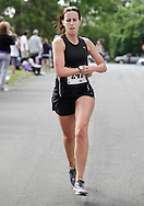 Middletown, New York - Kristin Matson of Middletown finishes the 15th annual Ruthie Dino Marshall 5K Run and Fun Walk hosted by the Middletown YMCA on Sunday, June 5, 2011. Matson won the women's 30-39 age group. ©Tom Bushey / The Image Works