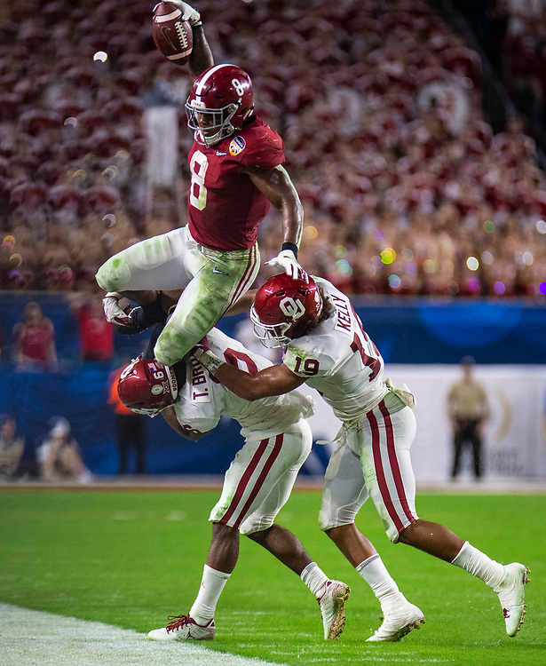 Dec 29  2018  Miami Gardens, FL , U.S.A.  Alabama running back Josh Jacobs (8) game stats 15 carries for 98 yards runs to the outside and jump over two Oklahoma defenders for short gain during the NCAA Capital One Orange Bowl Semifinal game between Oklahoma Sooners and the Alabama Crimson Tide 45-34 win at Hard Rock Stadium Miami Gardens, FL  Thurman James / CSM