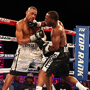 NEW ORLEANS, LA - JULY 14:  Charles Conwell (R) fights Travis Scott during the Regis Prograis v Juan Jose Velasco ESPN boxing match at the UNO Lakefront Arena on July 14, 2018 in New Orleans, Louisiana.  (Photo by Alex Menendez/Getty Images) *** Local Caption *** Charles Conwell; Travis Scott