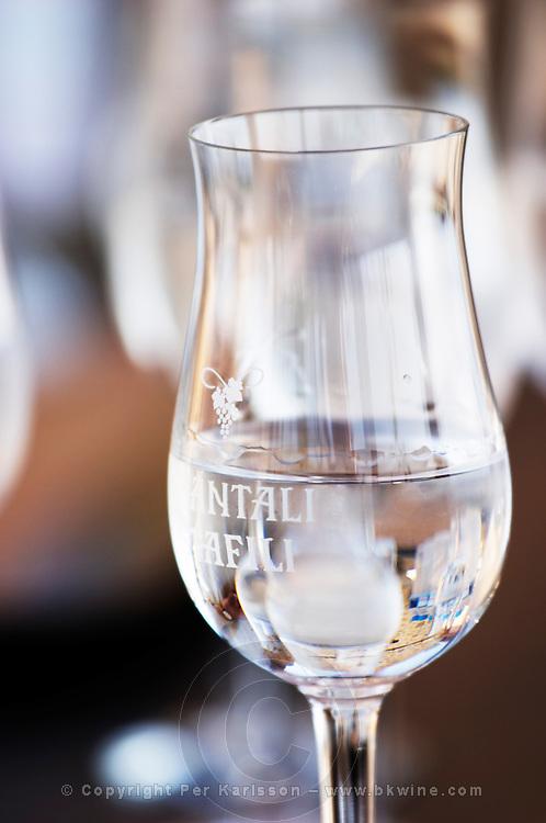 Glass of tsipouro. Tsantali Vineyards & Winery, Halkidiki, Macedonia, Greece.