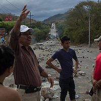 The Central American Highway, CA1, was blockaded at El Marillal near Choluteca for days during protests. Protestors lay rocks and concrete along the road and set fires on the bridge to stop any vehicles passing.