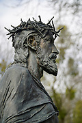Jesus with thorn crown in a cemetery