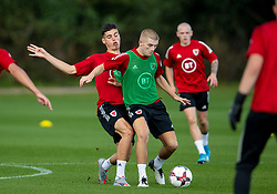CARDIFF, WALES - Monday, August 31, 2020: Wales' Jack Evans (Swansea City FC) (L) and Ryan Stirk (Birminham City FC) (R) during a training session at the Vale Resort ahead of the UEFA Under-21 Championship Qualifying Round Group 9 match between Bosnia and Herzegovina and Wales. (Pic by David Rawcliffe/Propaganda)