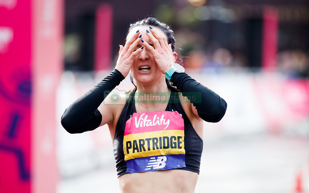 Lily Partridge after crossing the finish line to finish second in the women's race of the Vitality Big Half in London City Centre.