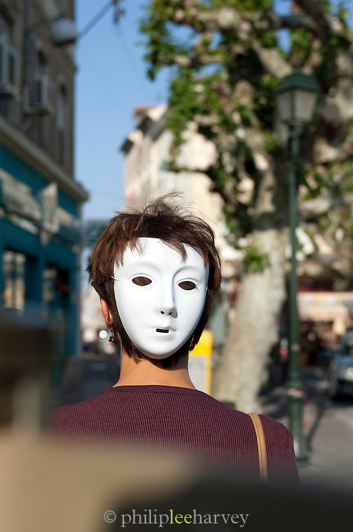 Person with a theatre mask in the Dordogne region of France