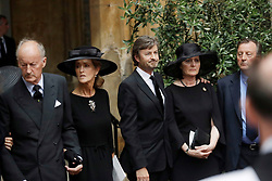 Lord Romsey (left) and his wife Penelope (second left) leave the funeral of Countess Mountbatten of Burma at St Paul's Church, Knightsbridge, London.