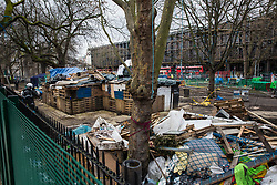 London, UK. 6th February, 2021. National Eviction Team bailiffs guard a protest camp in Euston Square Gardens previously occupied by environmental activists from anti-HS2 campaign group HS2 Rebellion. Bailiffs have been working on behalf of HS2 Ltd for the past eleven days to try to remove activists from tunnels dug by them beneath the site in order to seek to protect trees from felling in connection with the HS2 high-speed rail project.