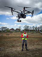 A qualified drone operator flying a DJI Inspire2 drone in England