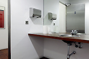 a modern washroom in a male public toilet facility