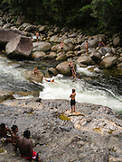 People enjoy playing in the Mossman River at Mossman Gorge, Daintree National Park, near Mossman, Queensland, Australia.
