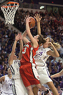 Nebraska's Kelsey Griffin (C) drives to the basket against Kansas State's Danielle Zanotti (R) and Shalee Lehning (R) at Bramlage Coliseum in Manhattan, Kansas, February 4, 2006.  The Huskers are tied at halftime 33-33.