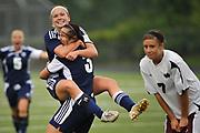 John Glenn High School's Emily Kraska (11) hugs her teammate Holly Duncan (3) after scoring the loan goal to end their double overtime regional opener against Holland Christian High School at Cedar Springs High School on June 8, 2010.