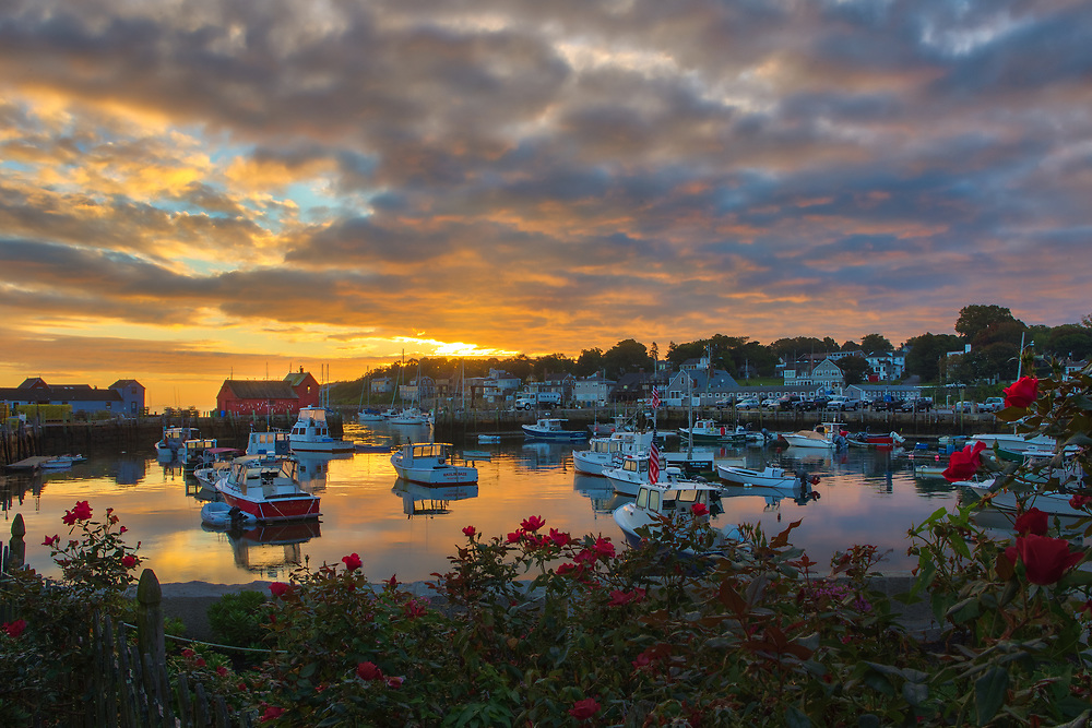 New England photography of Motif #1, a famous red fishing shack and historic landmark in Rockport, Massachusetts on Cape Ann. The photo captures the local fishing boats with the iconic landmark and a stunningly beautiful sunrise sky. The historic landmark is known throughout New England as Motif #1, so called because it is the most often painted building in America.<br /> <br /> This New England photo image of Rockport Motif Number 1 at sunrise is available as museum quality photography prints, canvas prints, acrylic prints, wood prints or metal prints. Prints may be framed and matted to the individual liking and decorating needs: <br /> <br /> https://juergen-roth.pixels.com/featured/picturesque-rockport-juergen-roth.html<br /> <br /> Good light and happy photo making!<br /> <br /> My best,<br /> <br /> Juergen<br /> Photo Prints & Licensing: http://www.rothgalleries.com<br /> Photo Blog: http://whereintheworldisjuergen.blogspot.com<br /> Instagram: https://www.instagram.com/rothgalleries<br /> Twitter: https://twitter.com/naturefineart<br /> Facebook: https://www.facebook.com