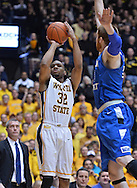 WICHITA, KS - JANUARY 18:  Guard Tekele Cotton #32 of the Wichita State Shockers puts up a shot against the Indiana State Sycamores during the first half on January 18, 2014 at Charles Koch Arena in Wichita, Kansas.  (Photo by Peter Aiken/Getty Images) *** Local Caption *** Tekele Cotton