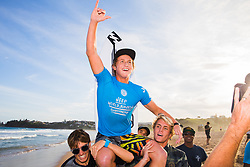 Finn McGill of Hawaii is chaired up the beach after winning the 2018 World Junior Championship when he defeated Joh Azuchi of Japan  in the final at Kiama, NSW, Australia.