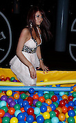 "REALITY TV star Amy Childs is clearly having a ball as she juggles her appearances on The Only Way Is Essex with her bid to become a glamour model.<br /> Amy 20, posed in a ball pool at the premiere of Johnny Knoxville flick Jackass 3D at the BFI Imax on London's South Bank.<br /> And she wrote online: ""Had a amaizing (sic) night...And yes I stood next to johnny Knoxville x x omg he is gorgeous x x"".<br /> Her fellow Essex star Jack Tweed turned in a pants display on the ITV2 show.<br /> Jade Goody's ex pulled down pal Mark Wright's shorts as he did pull-ups, to reveal a tiny pair of undies.<br /> Mark later did some punching with joker Jack . . . bet he wishes he'd worn his BOXER shorts now.<br /> ©James Curley/Exclusivepix"