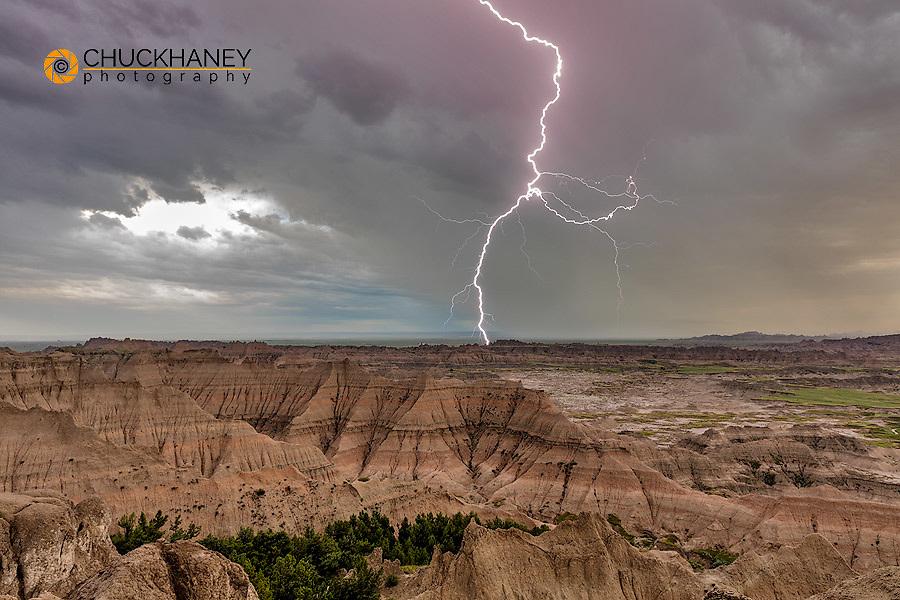 Lightning strike during thunderstorm from the Pinnacles Overlook in Badlands National Park, South Dakota, USA