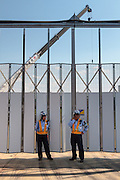 Security guards outside a gate to the construction site of the 2020 Tokyo Olympic stadium. Gaiemmae, Tokyo, Japan Friday June 10th 2016