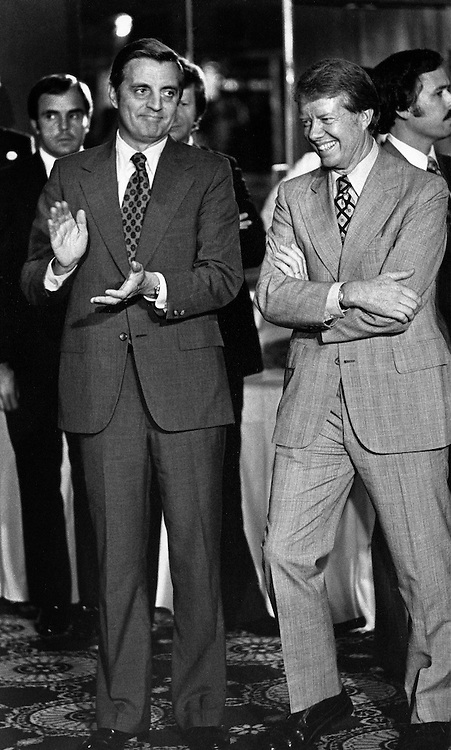 Vice President Walter Mondale laughs with President Jimmy Carter backstage before a speech to an organized labor meeting in Chicago, Illinois.