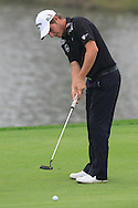 Emiliano Grillo (ARG) putts on the 17th green during Saturay's Round 3 of the 2014 BMW Masters held at Lake Malaren, Shanghai, China. 1st November 2014.<br /> Picture: Eoin Clarke www.golffile.ie
