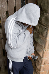 Boy text on his mobile phone,