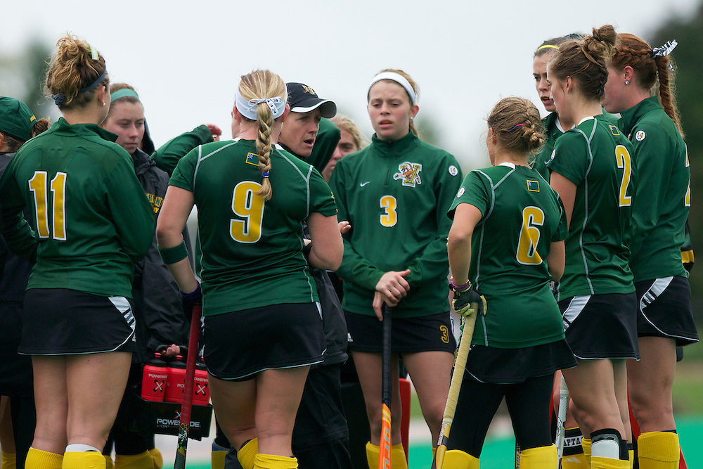Catamounts head coach Nicki Houghton talks to the players during a time out in the women's field hockey game between the Maine Black Bears and the Vermont Catamounts at Moulton/Winder Field on Saturday afternoon September 29, 2012 in Burlington, Vermont.