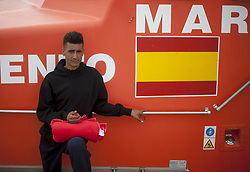 October 10, 2018 - Malaga, MALAGA, Spain - A migrant seen waiting to be disembarked from a rescue boat during his arrival at the Port of Malaga..Spain's Maritime Rescue service rescued 44 maghrebi migrants, a majority of them are from Rif aboard a dinghy at the Mediterranean Sea and brought them to Malaga Harbour where they were assisted by the Spanish Red Cross. (Credit Image: © Jesus Merida/SOPA Images via ZUMA Wire)